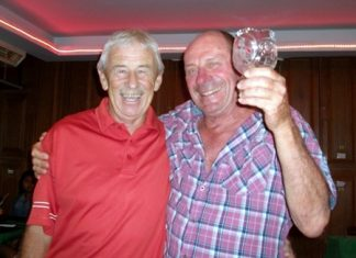 Terry Mangan (left) congratulates golfer of the month JJ Mafray.