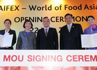 "Nattawut Saikuar (centre), Deputy Ministry of Commerce, presided over the opening of THAIFEX-World of Food Asia 2013 and was witness at the MOU signing ceremony between Dr. Sorajak Kasemsuvan (2nd right), President of Thai Airways International Public Company Limited (THAI), and Srirat Rastapana (2nd left), Director General of the Department of International Trade Promotion, to support ""Thai Select, Select THAI"" program which supports and promotes Thai food, Thai restaurants and meals served on THAI flights under the Thai Select brand."