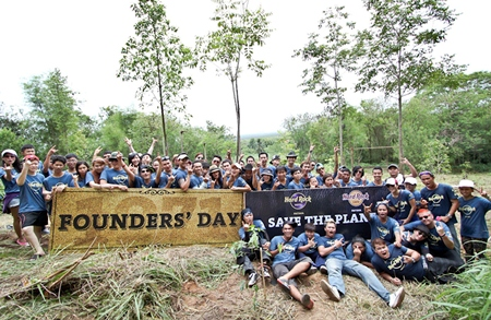 Hard Rock staff pose for a group photo at the Khao Chi-On non-hunting area in Sattahip, June 14.