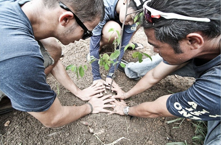 Staff members planted 100 trees in the in the park founded by HM the King.
