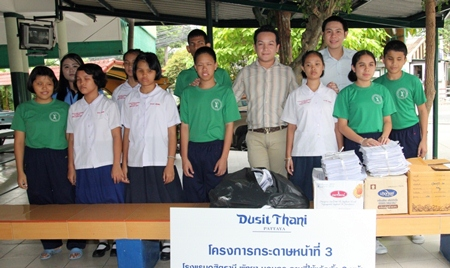 Arum Chaisomsri and Arwuth Tiampakdee (5th and 3rd from right respectively) represented Dusit Thani Pattaya in donating items that are useful in making Braille paper for the visually-impaired children at the School for the Blind in Pattaya. On the same day, the hotel also brought bottle tops that it collected and will be useful in making artificial legs for the physically-disabled kids at the Father Ray Foundation. The visits are part of the hotel's on-going CSR initiatives in the Pattaya community as well as in upcountry areas that include charity work for the underprivileged school children, temple restoration and facilities for hospitals.