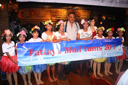 Peter (center) thanks the children from CPDC after their magical performance.