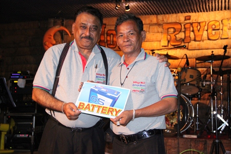 Peter Malhotra presents a 'much needed' battery to Boonlua Chatree, the longest tenured reporter at Pattaya Mail.