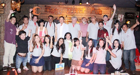 Senator Sutham Phanthusak (6th left) poses for a group photo with some of the Pattaya Mail Media Group staff