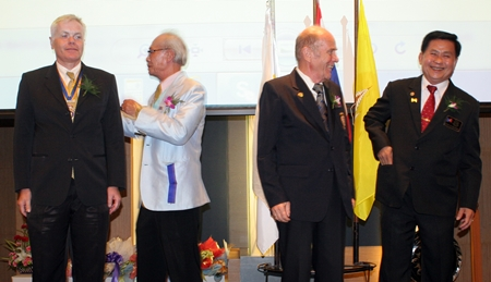 Outgoing president Heiner Moessing and incoming president Dr Otmar Deter of the Rotary Club Phoenix Pattaya participate in the installation rituals.