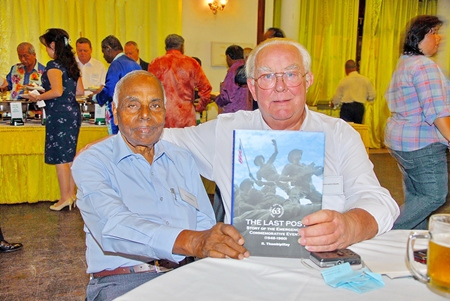 Mr S.K. Phillips receives a 'Signed Book' from Dato' R. Thambipillay DPMP, MBE. AM at Troops Night.