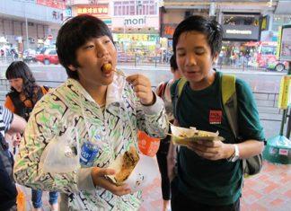 This tastes good! A Year 9 student samples some Hong Kong food.