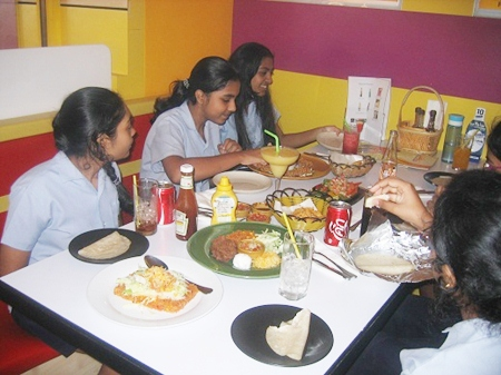 Tucking in to tacos - GIS students enjoyed their Spanish lunch.