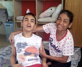 Tewid and his mother at the Camillian Home in Lat Krabang.