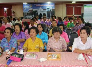 Chonburi residents listen in to a lecture about how they should keep their properties clean and tidy.
