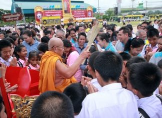 A highly revered monk works his way through the congregation, sprinkling them with holy water as they swear to stay away from narcotics.