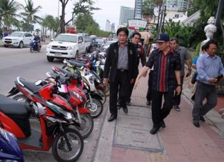 Pattaya Deputy Mayor Ronakit Ekasingh (left) and Banglamung District Chief Sakchai Taengho (center) inspect rentals taking up precious Beach Road and sidewalk real estate.