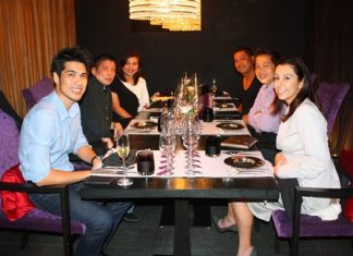 Siam Winery assistant winemaker Suppached Sasomsin (front left) and Tamara Demeo (front right), the Italian account manager for Siam Winery, enjoying the good food at Flare restaurant.