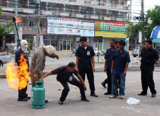 Residents and staff learn how to shut off a flaming gas tank.