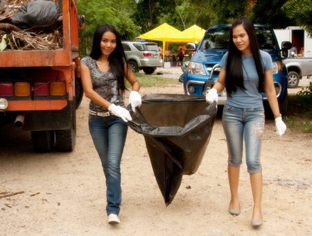 Local lassies help clean up Buddha Hill. (Photo by Aliona Mikhaylova)