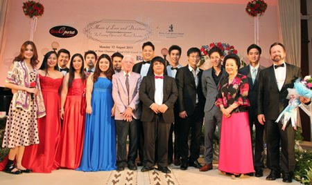 Grand Opera Thailand's performing artists stand alongside Royal Cliff's management on stage at the close of the performance.