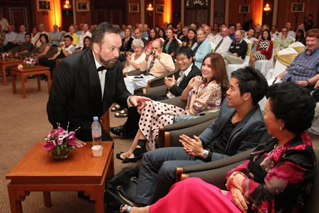 Stefan Sanchez, Artistic Director of Grand Opera Thailand (left) serenades the audience.