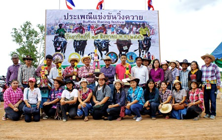 The owners of winning buffaloes pose for a group picture during the closing ceremony.