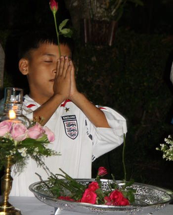 This young boy never met Father Ray, but still he pays his respect.