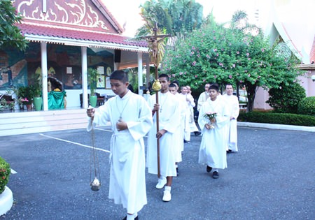 Alter boys lead the procession into the church.