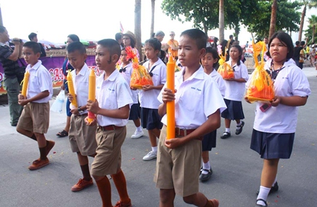 School children march with their Lent candles in this year's parade.