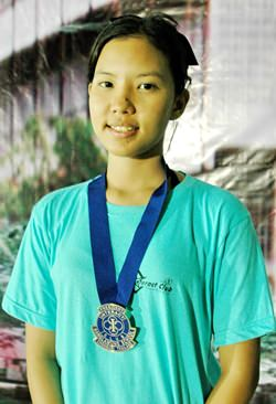 Lalita Phetphuang proudly wears her presidential seal from the Banglamung School Interact Club.