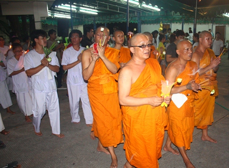 Monks perform the Wien Thien ceremony at Wat Khao Phra Yai, leading Buddhists on Asalaha Bucha Day.