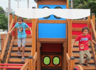 Oscar and Elijah, originally from London, test out the school's new pirate ship climbing apparatus.