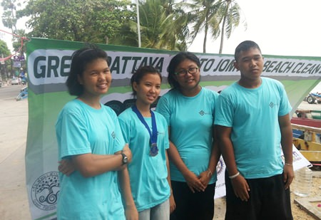 Interact students from Banglamung spend part of their holiday picking up trash on Jomtien Beach.