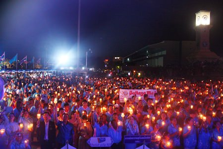 A sea of blue, illuminated by the soft glow of yellow candles, forms in front of the stage at Bali Hai pier to pay tribute to Her Majesty Queen Sirikit on her 81st birthday.  People throughout the Kingdom turned out in droves to honor this most remarkable lady on Motherfs Day, August 12.