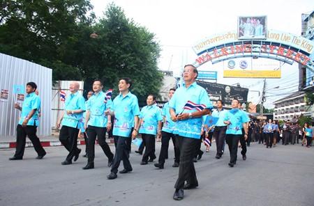 Tawit Chaiswangwong (4th left), chairman of Pattaya's city council, leads administrators in HM the Queen 81st birthday parade, with (L to R) Manoj Nongyai, Pattaya city council's deputy chairman, Deputy Mayor Wattana Chantanawaranon, Deputy Mayor Wutisak Rermkitkarn, and Sanit Bunmachai, Pattaya city council's deputy chairman.