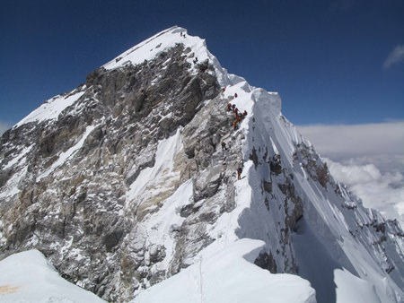 The peak of Everest, including the traffic jam on the infamous 'Hilary Step', as seen from the South Peak.