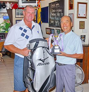 Mashi Kaneta (right) receives his Golfer of the Year trophy and prize from MBMG Group's Simon Philbrook.