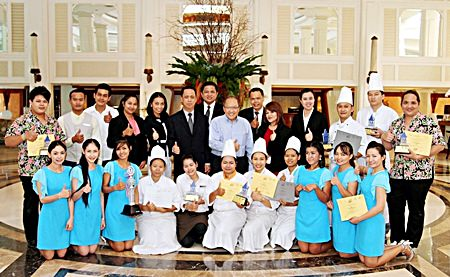 A proud Chatchawal Suphachayanont, general manager of Dusit Thani Hotel Pattaya (standing rear center), poses with his management and winning F&B staff members following the conclusion of this year's Bartender Competition.