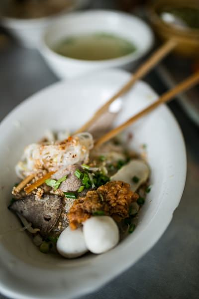 A popular breakfast choice for locals is a bowl of fish ball noodles at the old Naklua market.