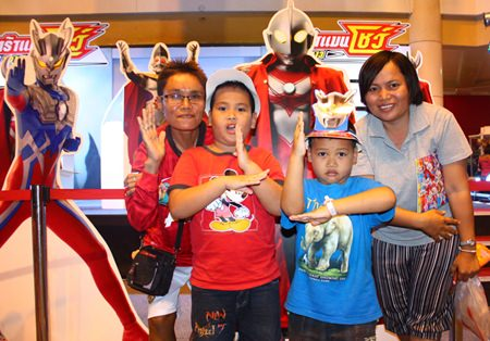 Children forming Ultraman Zero and Ultraman Dyna poses during the Ultraman event at Central Center Pattaya.