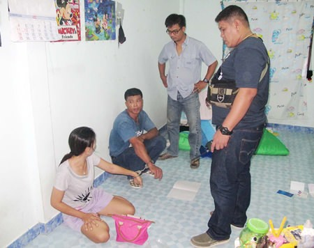 Amphan Kaewbutdee (seated, center) first blamed his wife, but later confessed to dealing illicit drugs.
