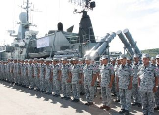 281 Thai sailors line up in front of the HTMS Sukhothai whilst preparing to sail to Indonesian waters for this year's Sea Garuda joint military exercises.