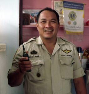 Sathir Khumklung works as a locksmith by day and a police volunteer at night.