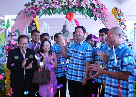 Mayor Itthiphol Kunplome rings the school bell to officially launch Pattaya School No. 9's 58th anniversary celebrations.