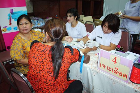 "Citizens receive blood tests to check for calories in their blood during the recent ""Pattaya Loves Health"" project."
