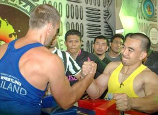 Champion arm wrestlers Arturs Dorohoff (left), winner of two categories, and Suttiwas Kohsamut (right), winner of the under 75kg event, face off in an exhibition bout during the 10th Pattaya International Arm Wrestling Championships held at the Royal Garden Plaza last weekend. 80 strong men from around the world competed for cash and trophies so big, only the strongest arms could carry them home.