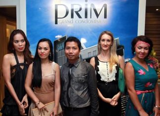 Porchland Group CEO, Chisanucha Phakdeesaneha (center), poses with guests at the launch of the Prim Grand Condominium on Oct. 8.