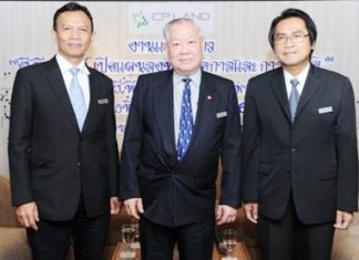 Sunthorn Arunanondchai, President & CEO of CP Land Plc (center) poses for a photo with Executive Vice President Somkiat Ruentongdee and Vice President of Facility Management, Salya Mulasastra.
