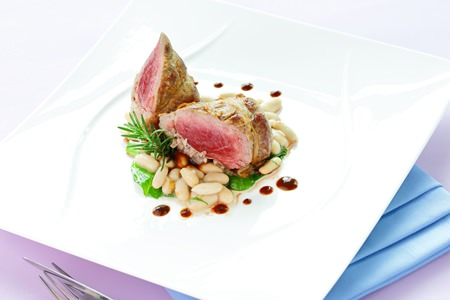 Acqua lamb fillet on canellini beans.