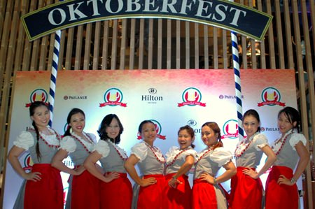 Hilton Pattaya maids in their sexy 'drindls' bid 'willkommen' as guests arrived.