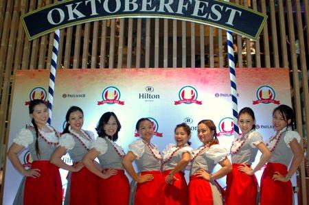 Hilton Pattaya maids in their sexy 'drindls' bid 'willkommen' as guests arrived.
