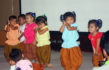 """Mini's"" from the North Star Library and Father Ray Community Center perform the ""nong-pee-seuah"" (""Caterpillar show"") dance their little bodies on stage as a special entertainment during the ""Smart Baby Smart Brain"" program at the Bangkok Hospital Pattaya."