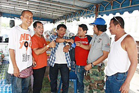 He just wanted to help - Jakrit Mukpradap (center) was arrested for drug possession when trying to donate ya ba to the flood relief effort.