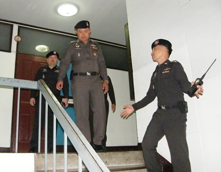 Newly installed Region 2 police commander Lt. Gen. Kawee Suphanant (top of stairs) expressed his discontent with the lack of cleanliness at Pattaya Police Station.